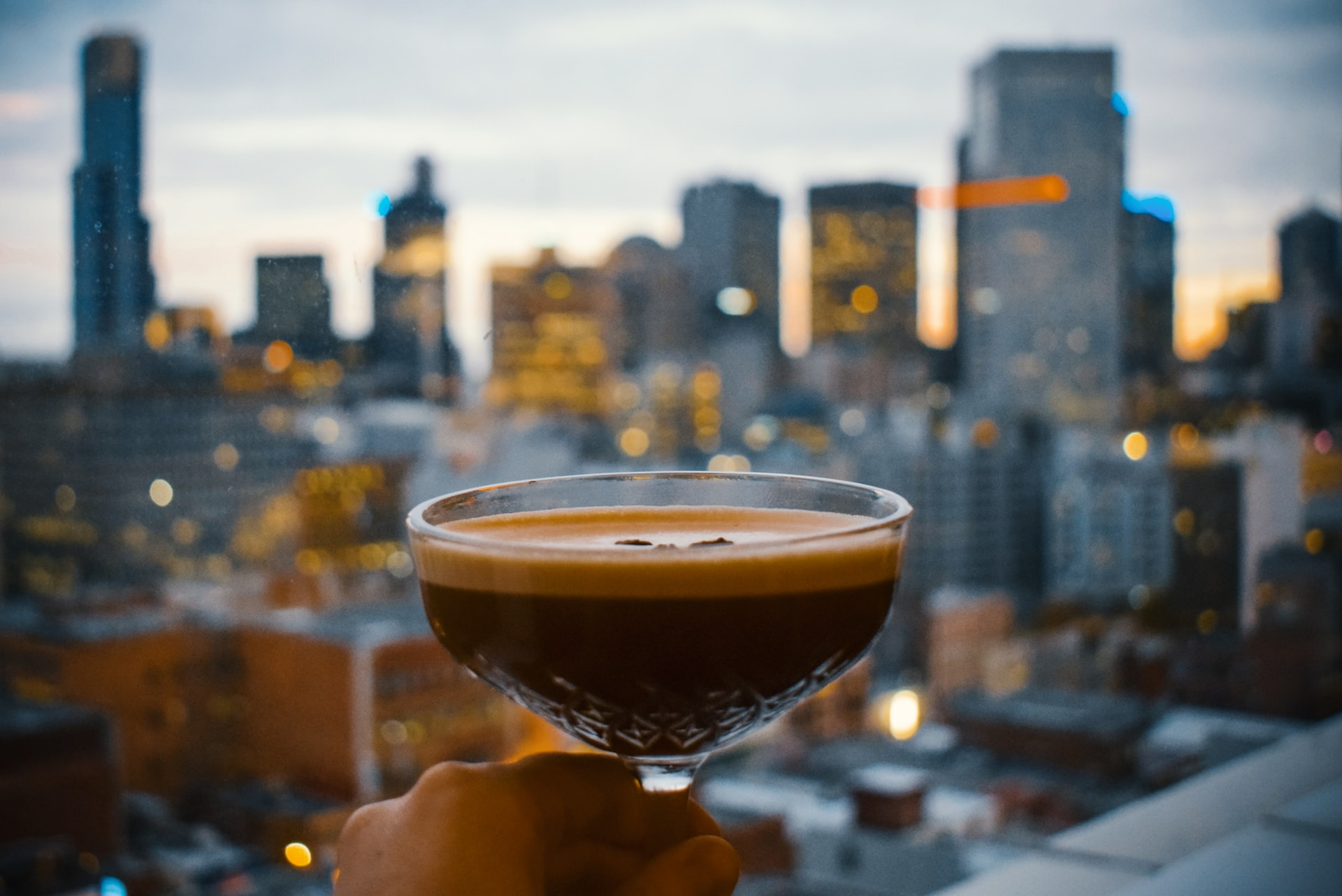 espresso martini in front of the Melbourne skyline